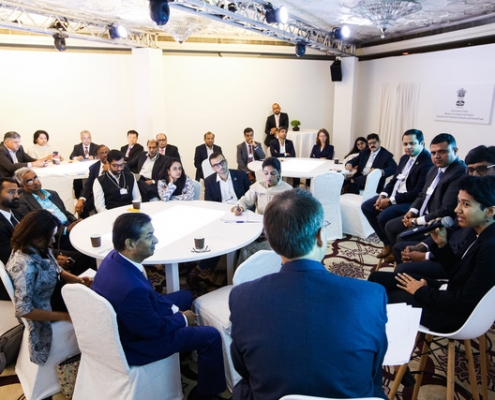 "Participants roll up their sleeves to map new ""ways for water"" during a work session at the World Economic Forum India Economic Summit. (Photo: World Economic Forum)"