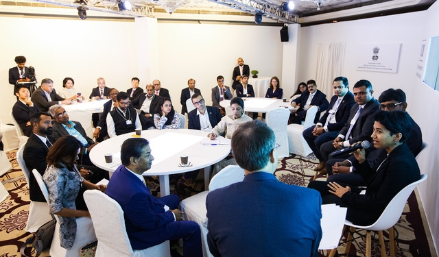 """Participants roll up their sleeves to map new """"ways for water"""" during a work session at the World Economic Forum India Economic Summit. (Photo: World Economic Forum)"""