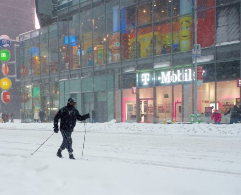 Cross-country skiing in an empty Times Square, New York, in 2016. Extreme weather events topped list of most likely risks to profoundly affect the world in the next 10 years. Photo by Cody Pope/Vector Center.